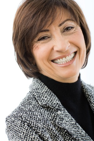 Closeup portrait of happy businesswoman wearing grey suit, smiling and looking at camera. Isolated on white background.