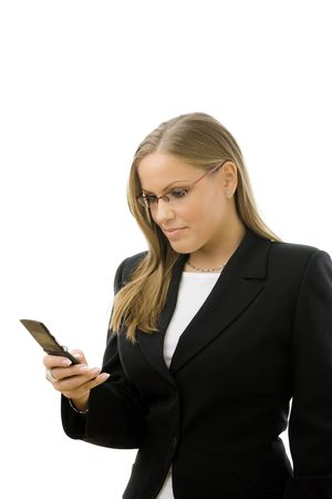Young happy businesswoman writting text message on mobile phone, smiling, isolated on white background.