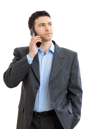 Casual businessman talking on mobile phone. Isolated on white.