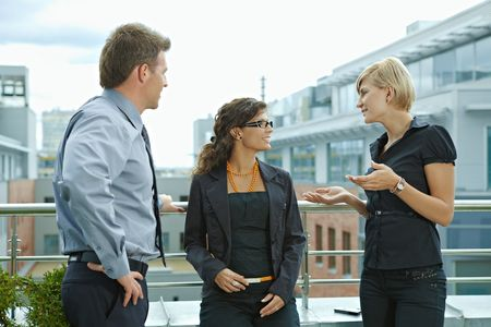 Photo for Business people having break and talking on terrace of office building. - Royalty Free Image