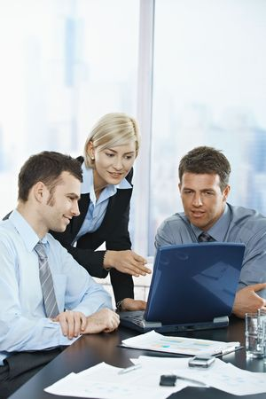 Happy business people talking on meeting at office, smiling,