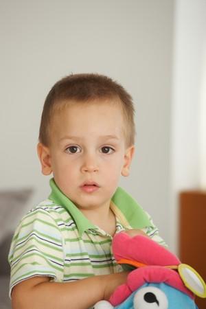 Photo pour Portrait of little boy (3-4 years) looking at camera. Copyspace above. - image libre de droit