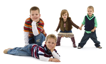 Group of 4 happy children posing together.  smiling. Isolated on white background.