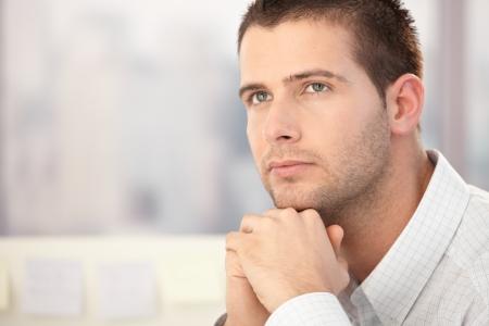 Portrait of handsome man thinking.