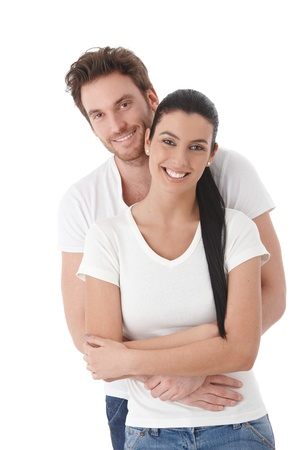 Portrait of happy young couple, hugging, smiling.