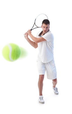 Goodlooking tennis player prepared for backhand stroke,