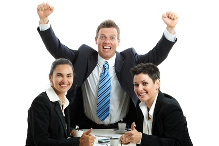 Happy business team celebrating business success at coffee table, isolated on white.