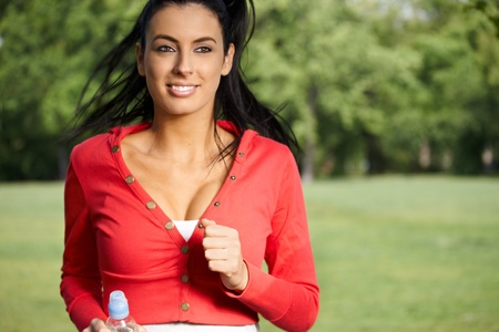 Pretty girl running in park in springtime.