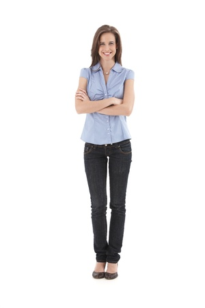 Young pretty office worker girl standing with arms folded, smiling happily, isolated on white, full length.