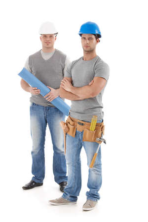 Engineer and handyman in protective hat, looking at camera, isolated on white, full size.