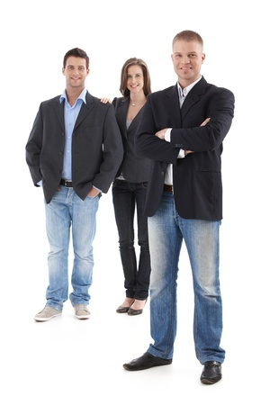 Goodlooking young casual businesspeople posing in studio, smiling, looking at camera, cutout, full length.