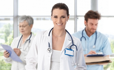 Female doctor leading medical professionals.ᅵ