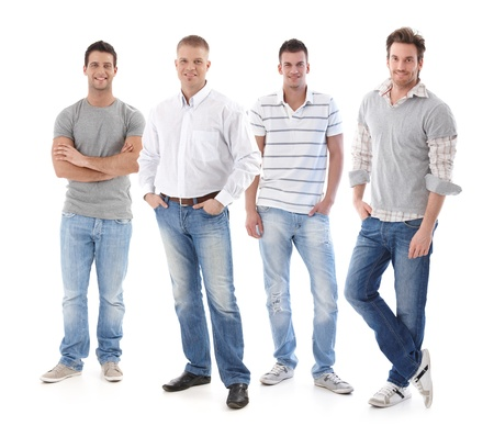 Full-length portrait of group of young men wearing jeans, looking at camera, smiling.の写真素材