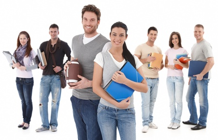 Foto de Group portrait happy of college students, smiling young couple in front. - Imagen libre de derechos
