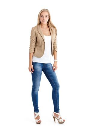 Foto de Attractive blonde teenager in trendy jeans and high heels, full length studio portrait. - Imagen libre de derechos