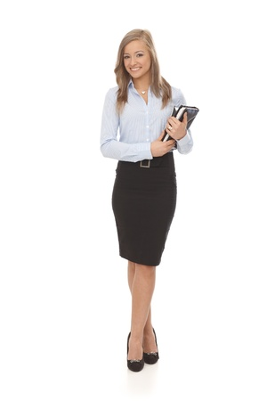 Full size photo of happy young blonde businesswoman holding personal organizer.
