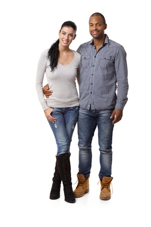 Attractive mixed race couple embracing, smiling.