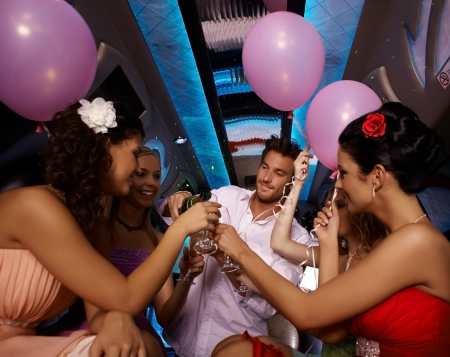 Photo pour Party time in limo with young females and handsome man. - image libre de droit