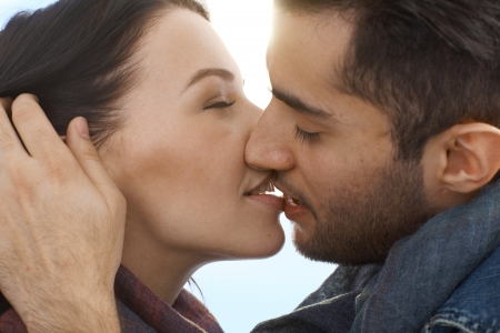 Photo for Closeup photo of young loving couple kissing. - Royalty Free Image
