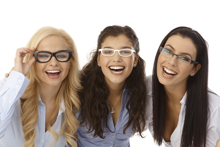 Close-up portrait of beautiful young women wearing glasses, smiling happy, looking at camera.の写真素材