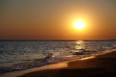 Sunset on a common beach, landscape photo.