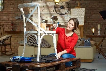 Photo pour Diy woman painting, renewing chair at home. - image libre de droit