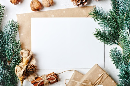 Photo for Merry Christmas and happy New year. Mockup with postcard and branches of a Christmas tree on white background. Background with copy space. Top view. Christmas background. Horizontal. - Royalty Free Image