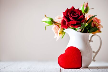 Photo for Greeting card with flowers and heart. Background with copy space. Selective focus. - Royalty Free Image
