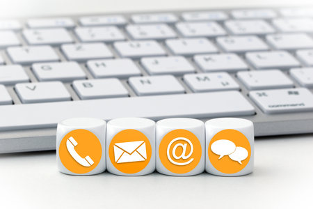 Photo for Website and Internet contact us page concept with colored icons on cubes - Royalty Free Image