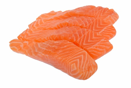 Four raw slices of salmon isolated on white background