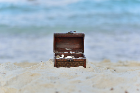 Treasure chests in the sand on the seashore: Royalty-free images