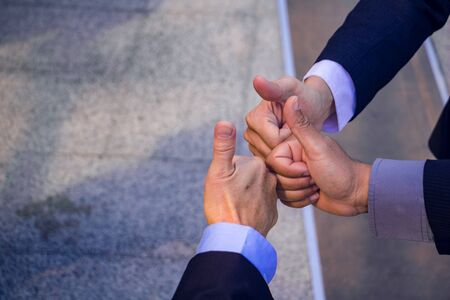 Business teamwork.They are join hands  mean teamwork  and spirit.together, develop,connection.Photo concept My partner Business and Success.