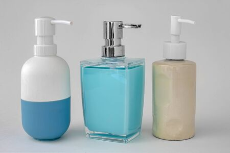 Photo pour Colorful soap dispenser for bathrooms or kitchen sinks on a white background - image libre de droit