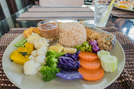 set rice Spicy Shrimp Paste and Chill Sauce Served with Mixed colorful  Vegetable in plate .(Nam Prik Ka Pi)
