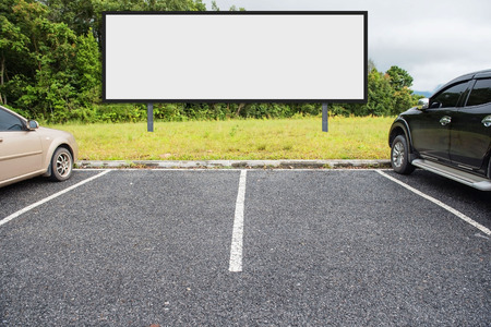 Photo for outdoor car parking and empty white billboard .Blank space for text and images. - Royalty Free Image