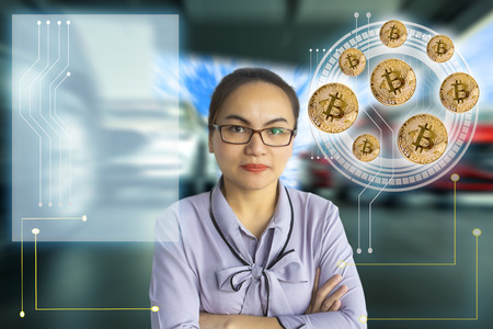 Asian woman business finger pointing tecnology bit coin in blurry car office background. For business people, finance, lifestyle and ethereum or block chain tecnology image