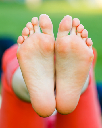 Closeup photo of young woman bare feet