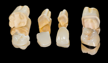 Dental ceramic crowns on isolated black background