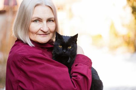 Foto für Photo of beautiful senior woman with black cat - Lizenzfreies Bild