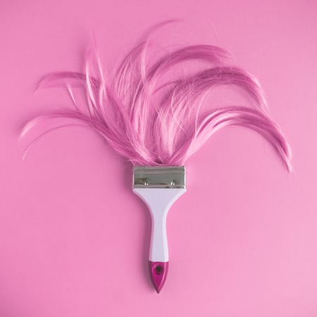 Photo for Paintbrush with long pink hair flat lay minimal creative background. - Royalty Free Image