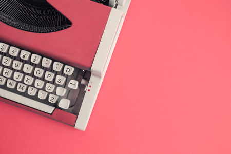 Photo for Top view of red vintage typewriter on table. Space for copy. - Royalty Free Image
