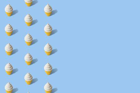 Foto de Ice cream in cone summer pattern on blue background minimal creative concept. Space for copy. - Imagen libre de derechos