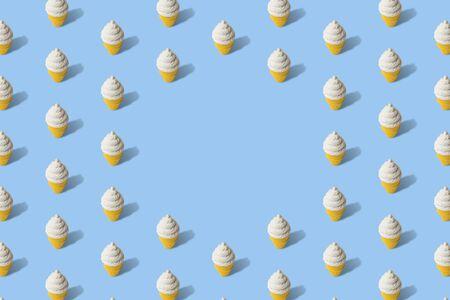 Foto de White ice cream in cone texture pattern abstract isolated on blue. Space for copy. - Imagen libre de derechos