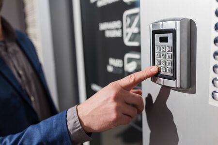 Photo for Close up of businessman hand entering security system code. - Royalty Free Image