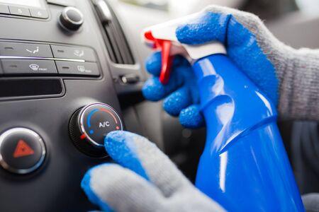 Foto de Detailed Cleaning of Modern Car Interior. Automotive Theme. Air conditioner testing. - Imagen libre de derechos