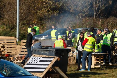 Guipavas, France - November 24, 2018 : Demonstrators called yellow vests during a demonstration against the increase of fuel cost, expensive living costs and high rate of taxation