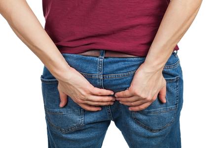 Photo pour Back view - young man holding his butt having severe diarrhea, need to poop - image libre de droit