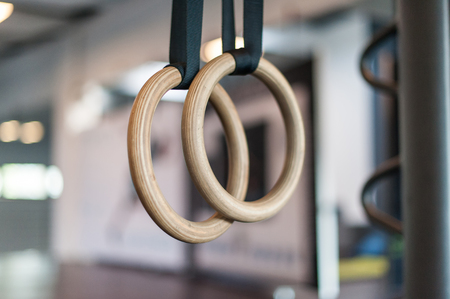 Photo pour Wooden turn rings in fitness hall - image libre de droit
