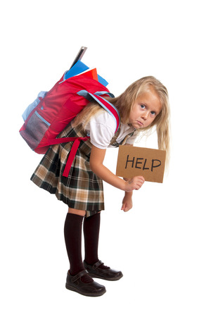 Photo for sweet little blonde schoolgirl asking for help carrying heavy backpack or school bag full causing stress and pain on back - Royalty Free Image