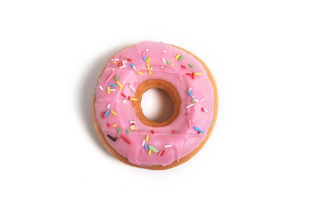 delicious and tempting pink donut with toppings isolated on white background in unhealthy nutrition and sugar and sweet cake addiction concept